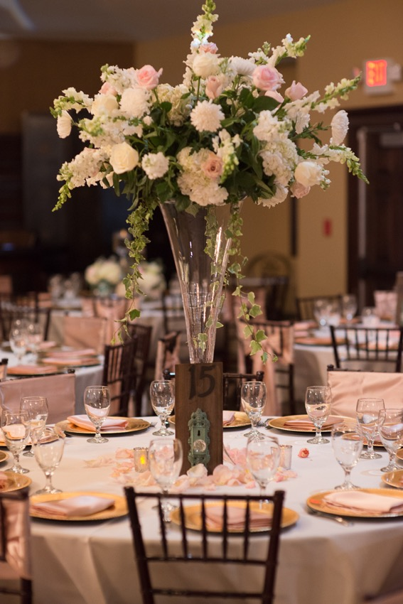 Large floral centerpiece of roses, hydrangea, chrysanthemums, snapdragons and English ivy