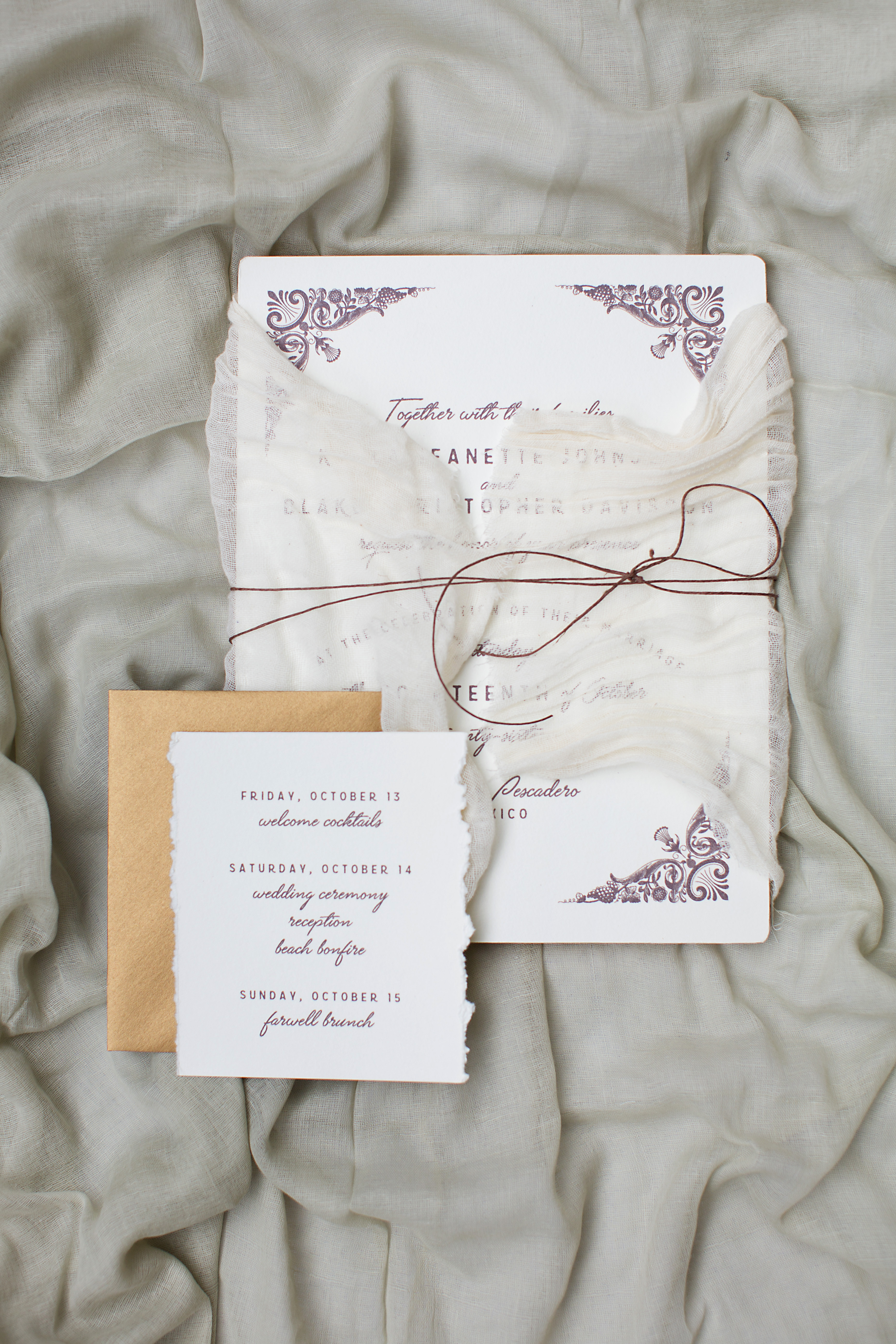 Oversized Invitation wrapped in raw linen with leather twine and hand deckled informational card