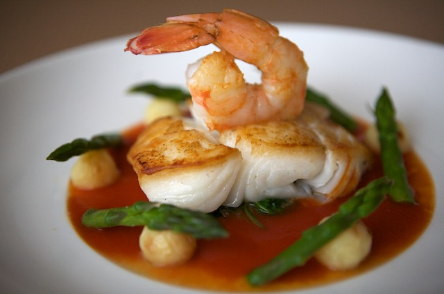 Pan Roasted Alaskan Halibut and Poached Shrimp with Wilted Spinach, Parisian Potatoes, Asparagus Tips and Horseradish - Tomato Broth