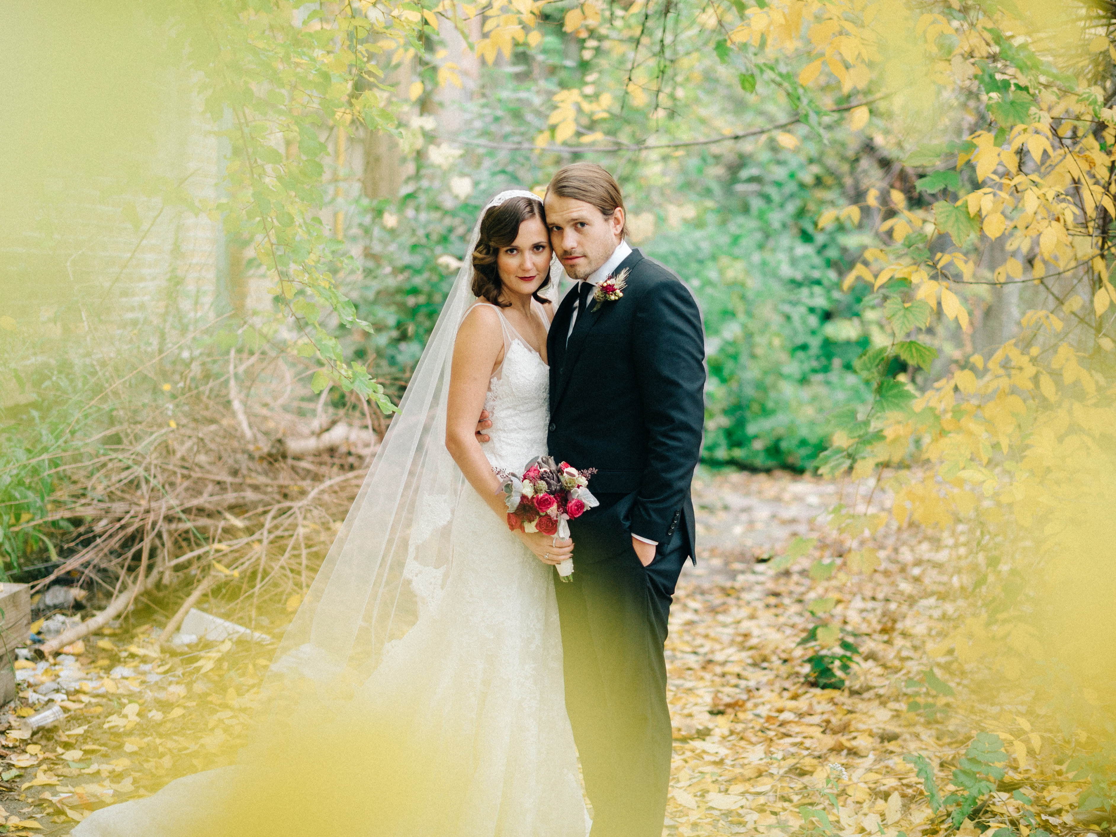 Our gorgeous couple, framed with fall foliage.