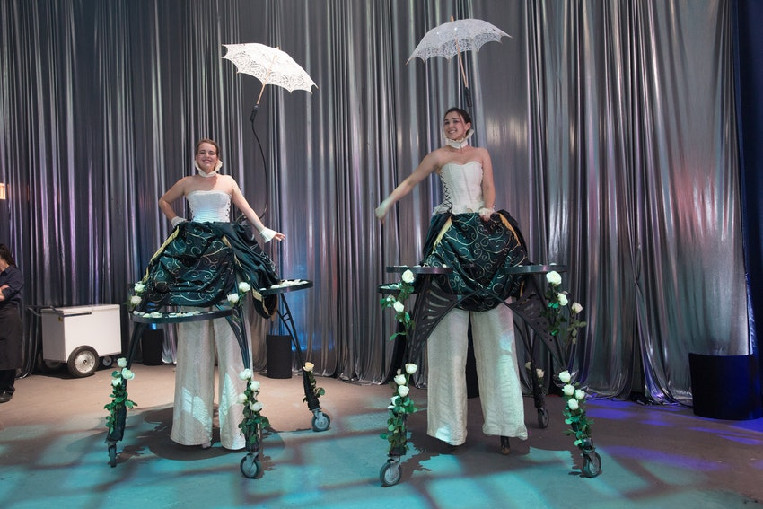 Stilted servers passed elegant appetizers to the guests during the Senior Lifestyle Corporation party.