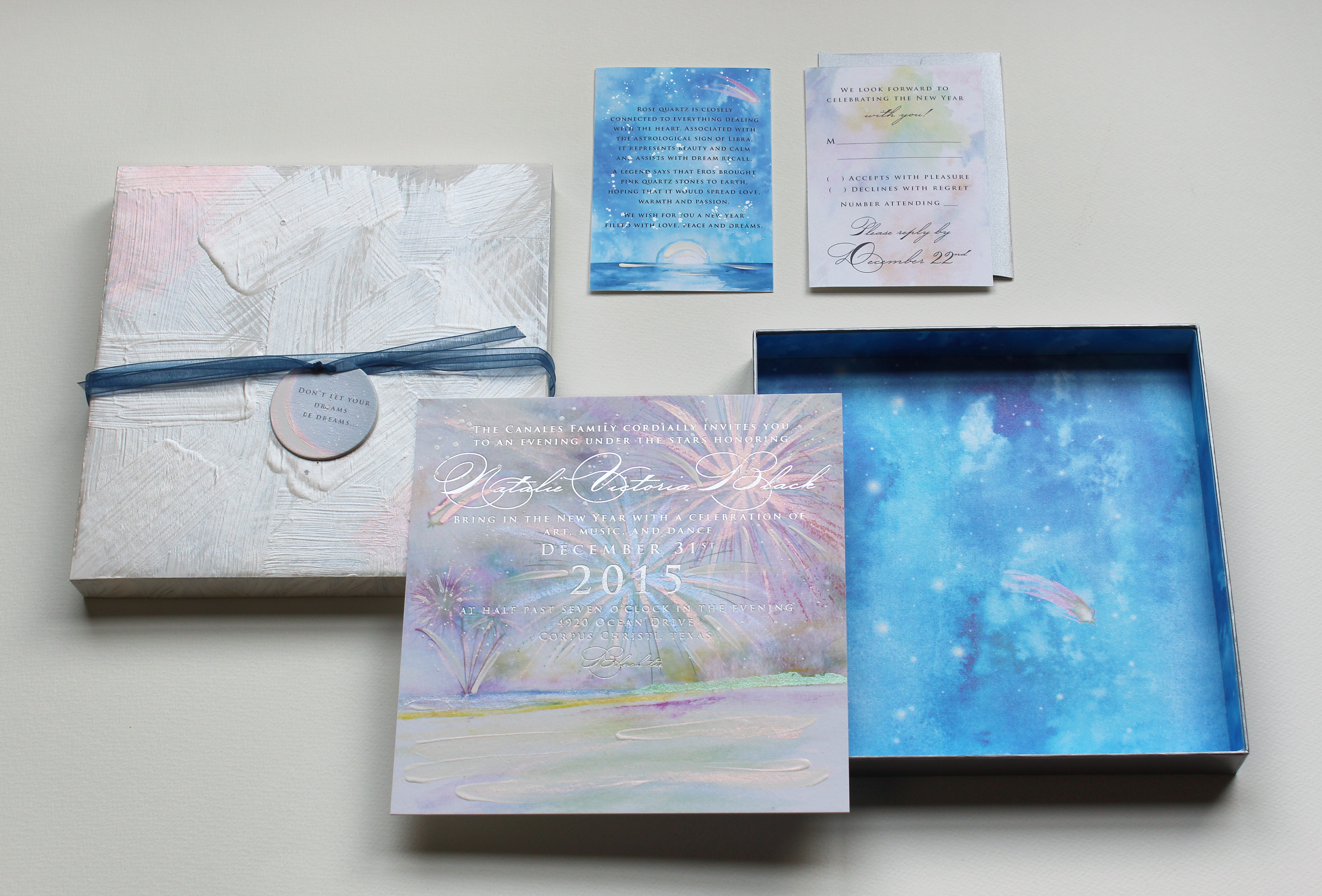 Glamorous celestial New Year's Eve invitation with silver foil and shimmery hand painted details.