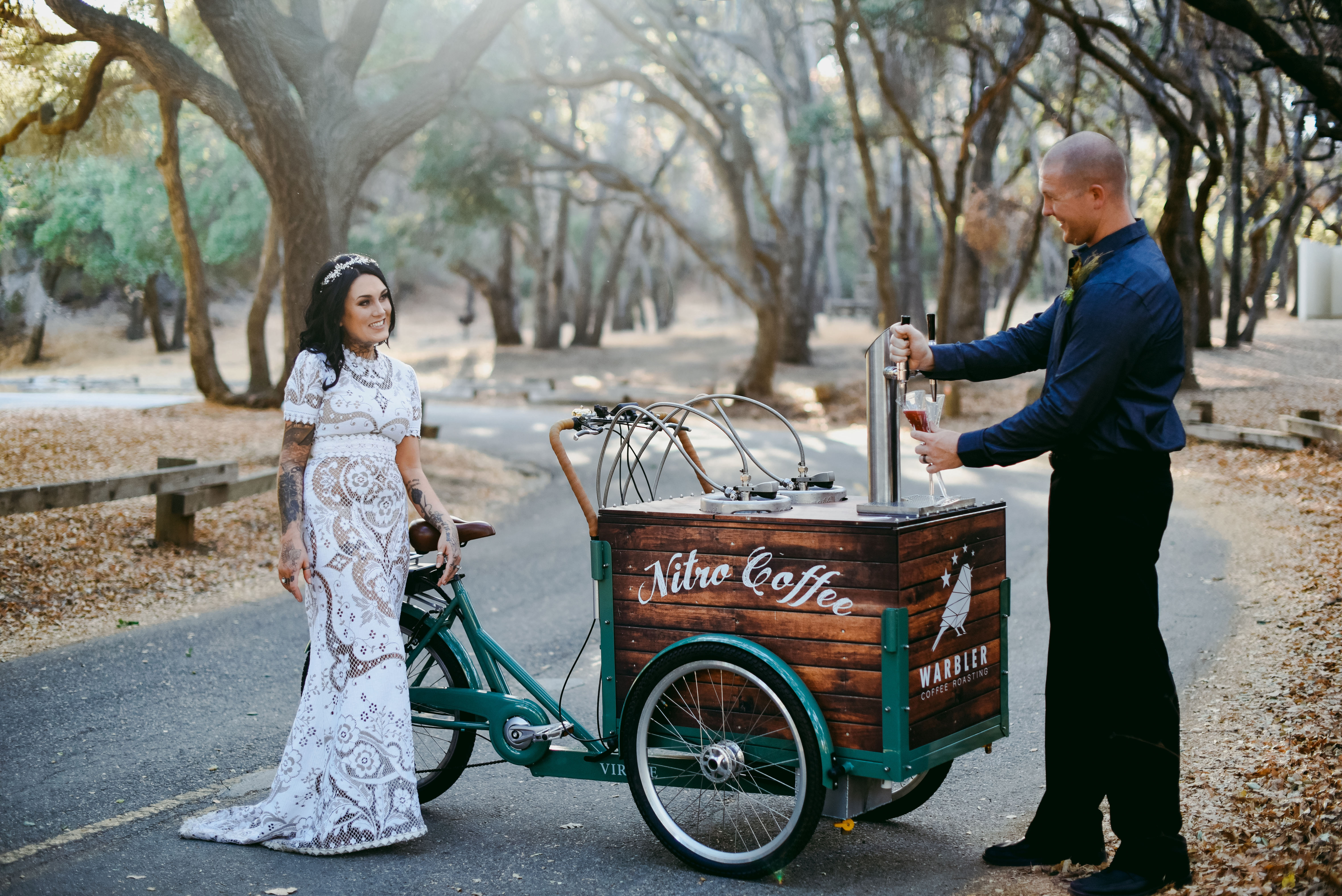 Bride and Groom pose with the Nitro Trike