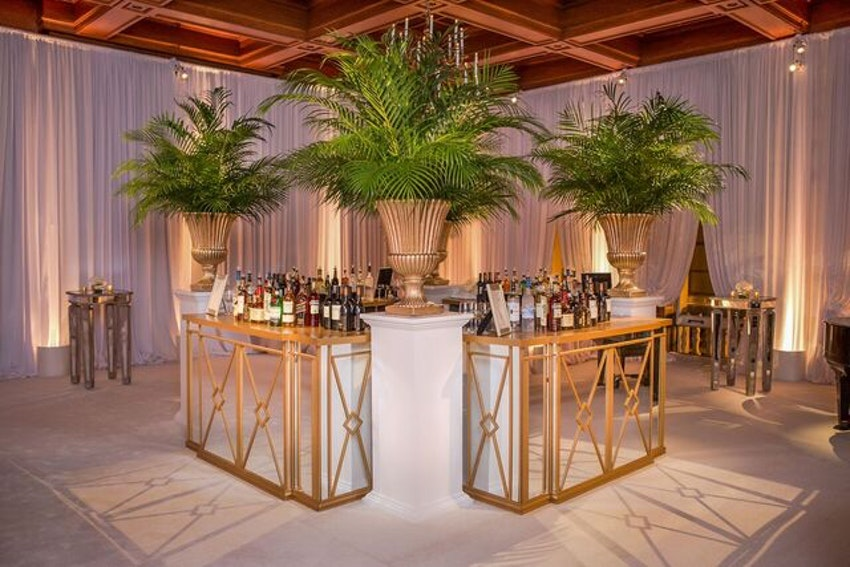 Mirrored bars and white carpeted ballroom for the cocktail hour.