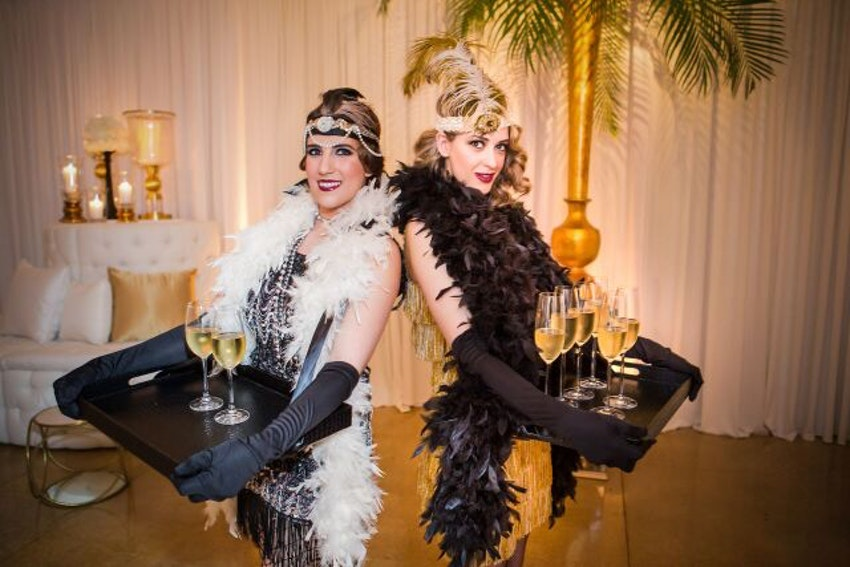 Gorgeous champagne models serving the guests at the party.