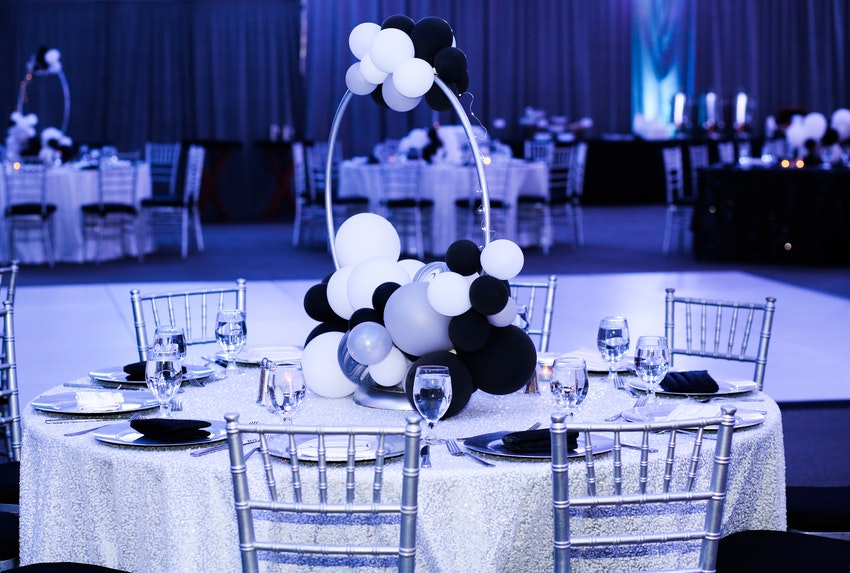 Hoop style whimsical balloon centerpiece with twinkle lights. Something different and unexpected, but with clear view to the stage.