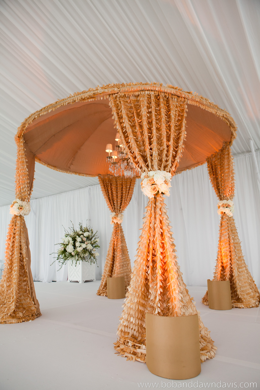 A bespoke wedding canopy with gold leaf detailing completes our bride's dream design.
