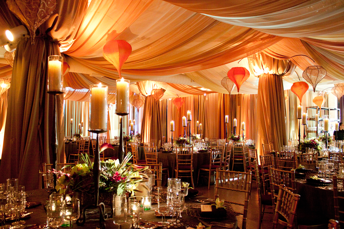 Layers of sumptuous drapery cascading from above bring intimacy to this Moroccan inspired soiree.