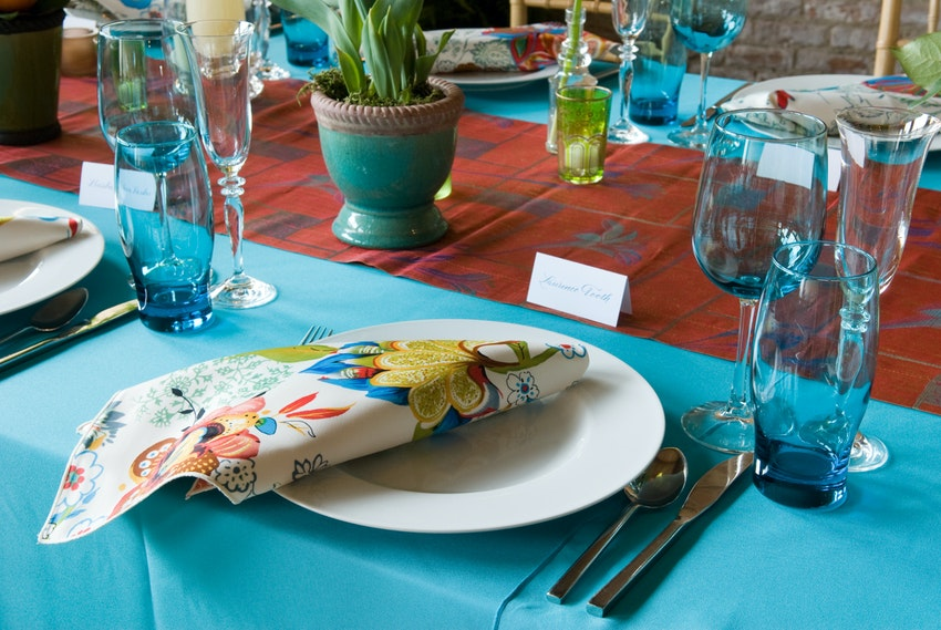Turquoise glassware mirrors the Hamptons beach theme of this birthday party.