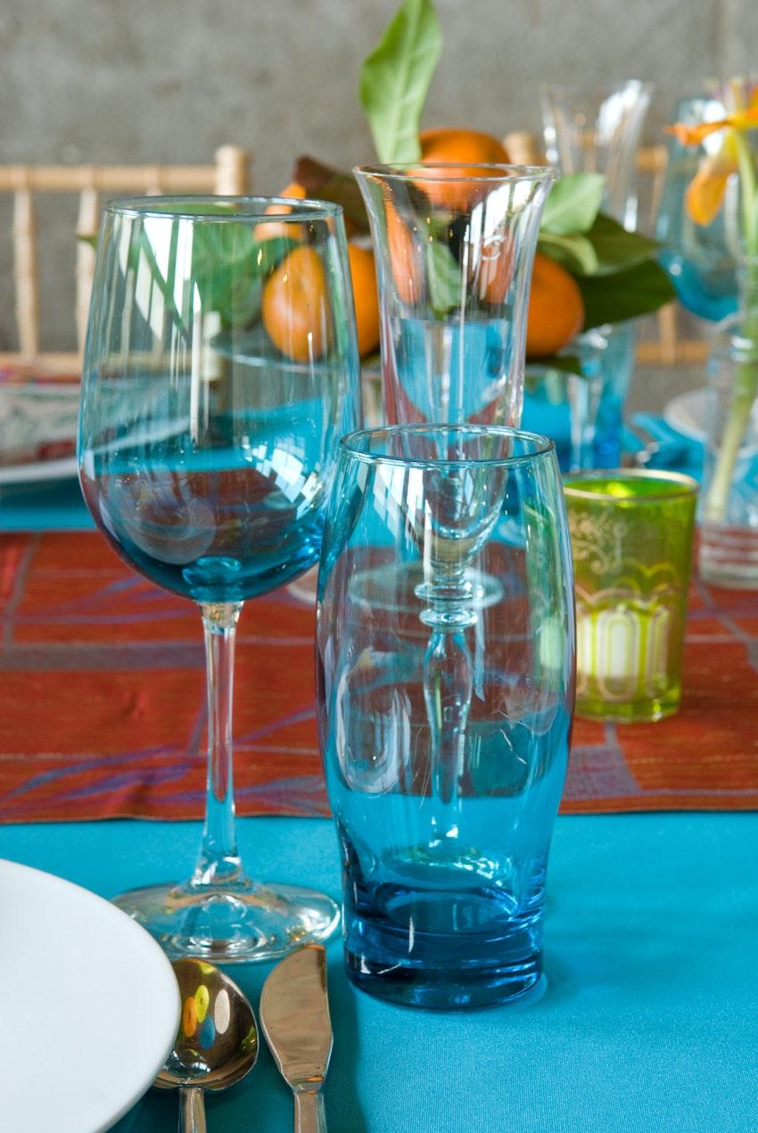 Statement blue glassware alongside citrus centerpieces.
