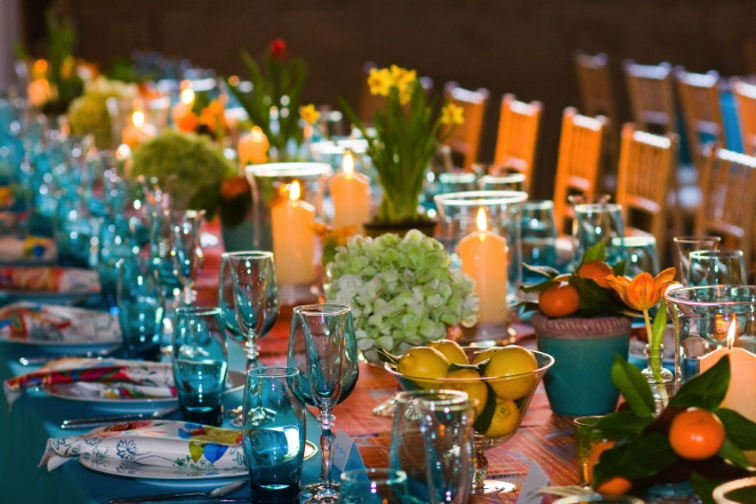 Bursts of color shine through colorful glassware and floral centerpieces.