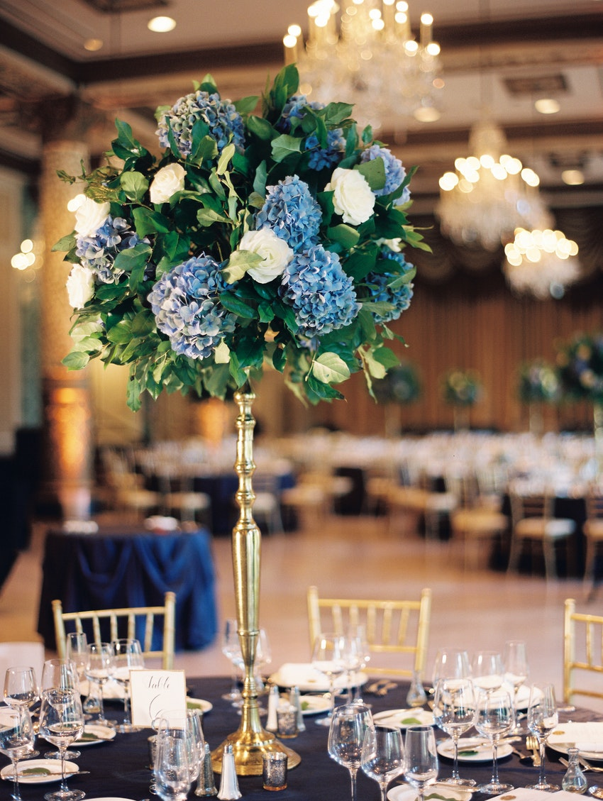 High Profile Centerpiece of Hydrangea, Solal and White Tibet Roses on Gold Stand