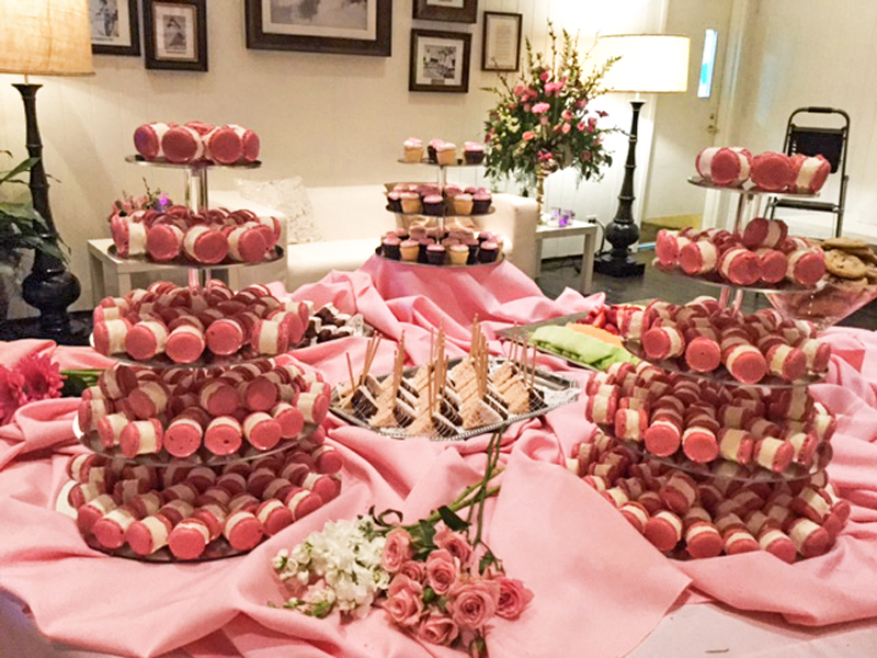 Bridal shower treats display featuring pink macaroons.