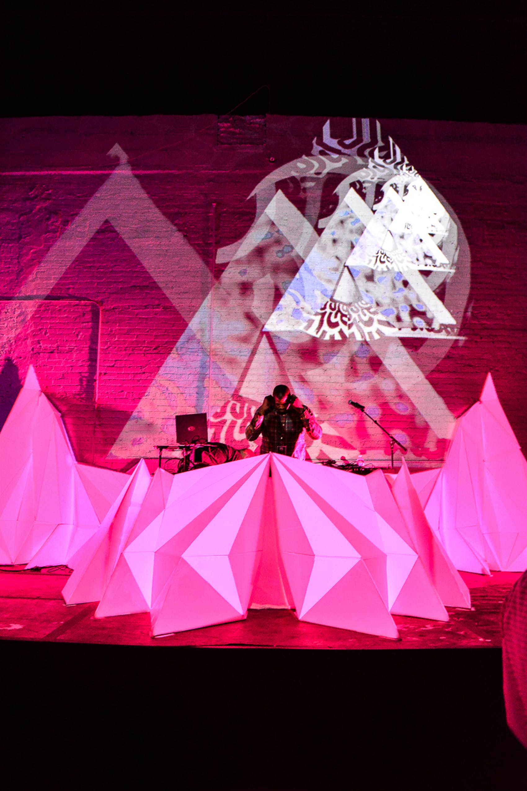 bright pink shapes forming dj booth at corporate new year's eve celebration