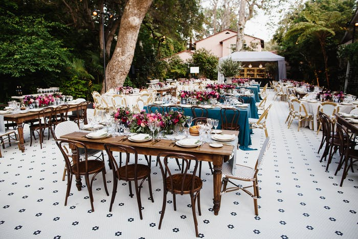 Tiled outdoor floor with wooden tables and chairs.