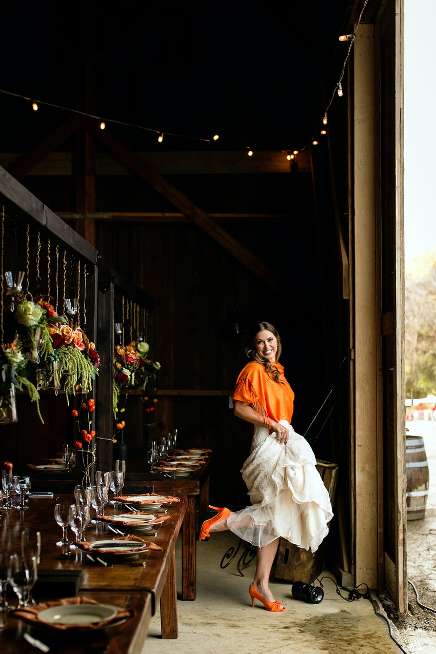 bride in orange at barn reception