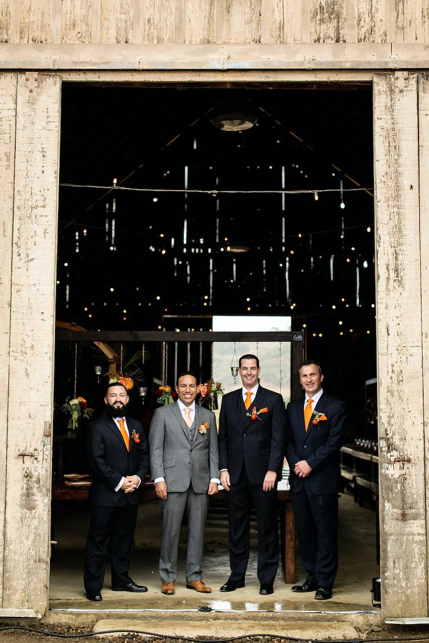 groom and groomsmen barn vineyard wedding
