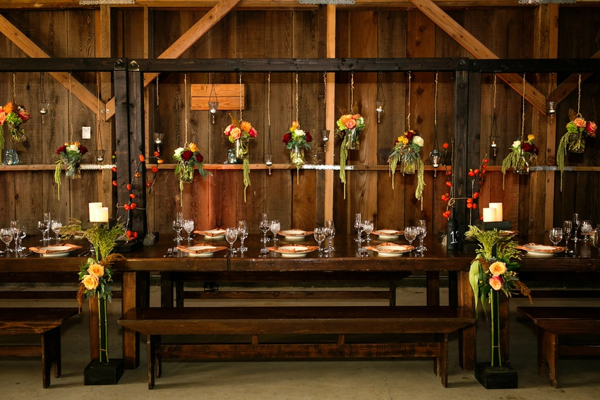wedding reception custom tables with arbors and hanging flowers