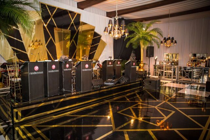 Custom black and gold dance floor and band backdrop.