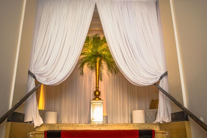 Gorgeous white drapery to make for an unforgettable entrance for guests.