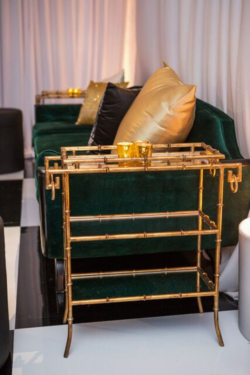 Antique gold bar cart to give the Racquet Club a residential feel.