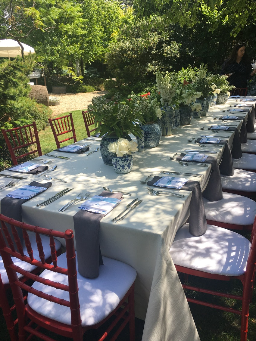 Table set for (20) in the garden using blue and white porcelain provided by