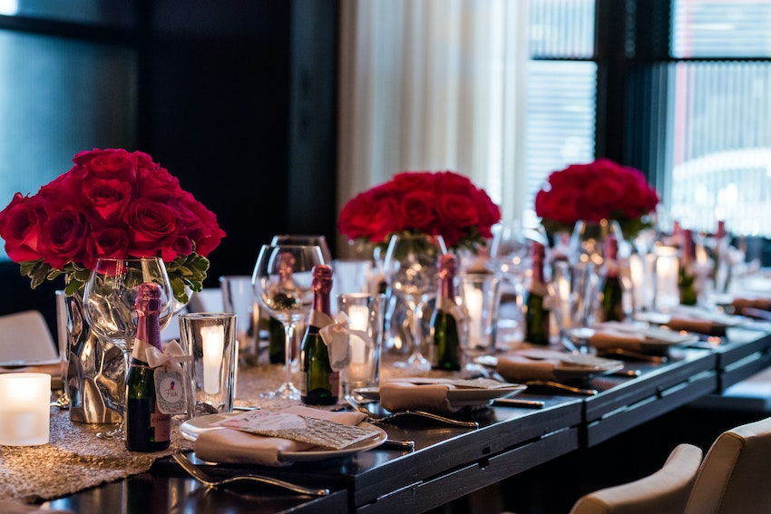Lush pink roses in regal vases lined the table for the perfect centerpiece.