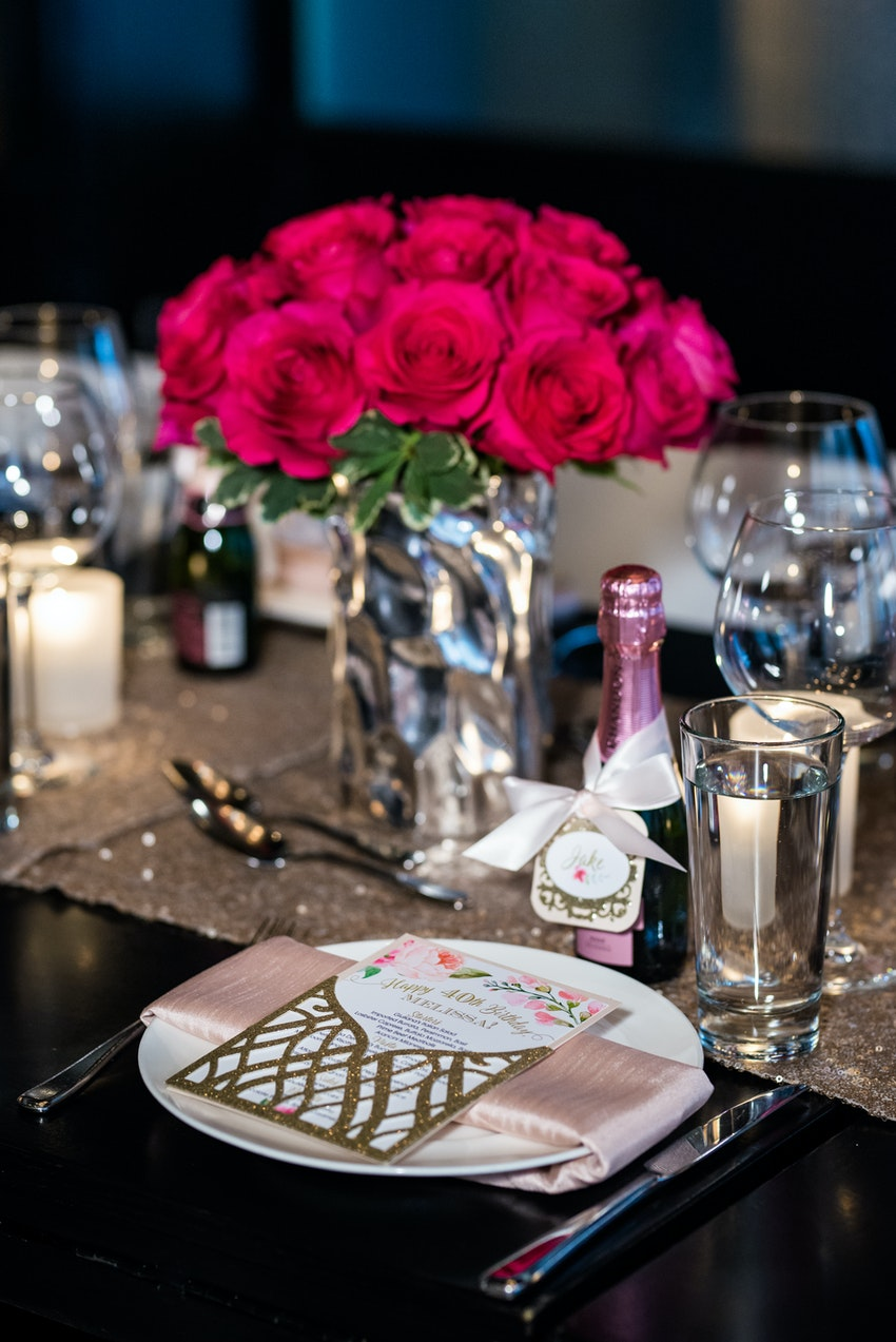 Glittering table runners and mini pink champagne bottles bordered each setting as a parting gift. No detail was left untouched at each setting.