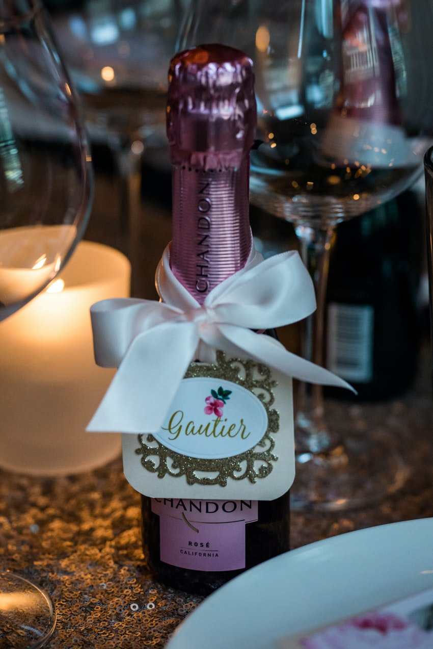 Personalized tags on each bottle stood as place cards for guest's seating assignment.