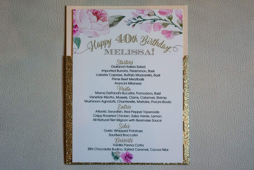 Pink florals and gold glitter decorated each customized menu.