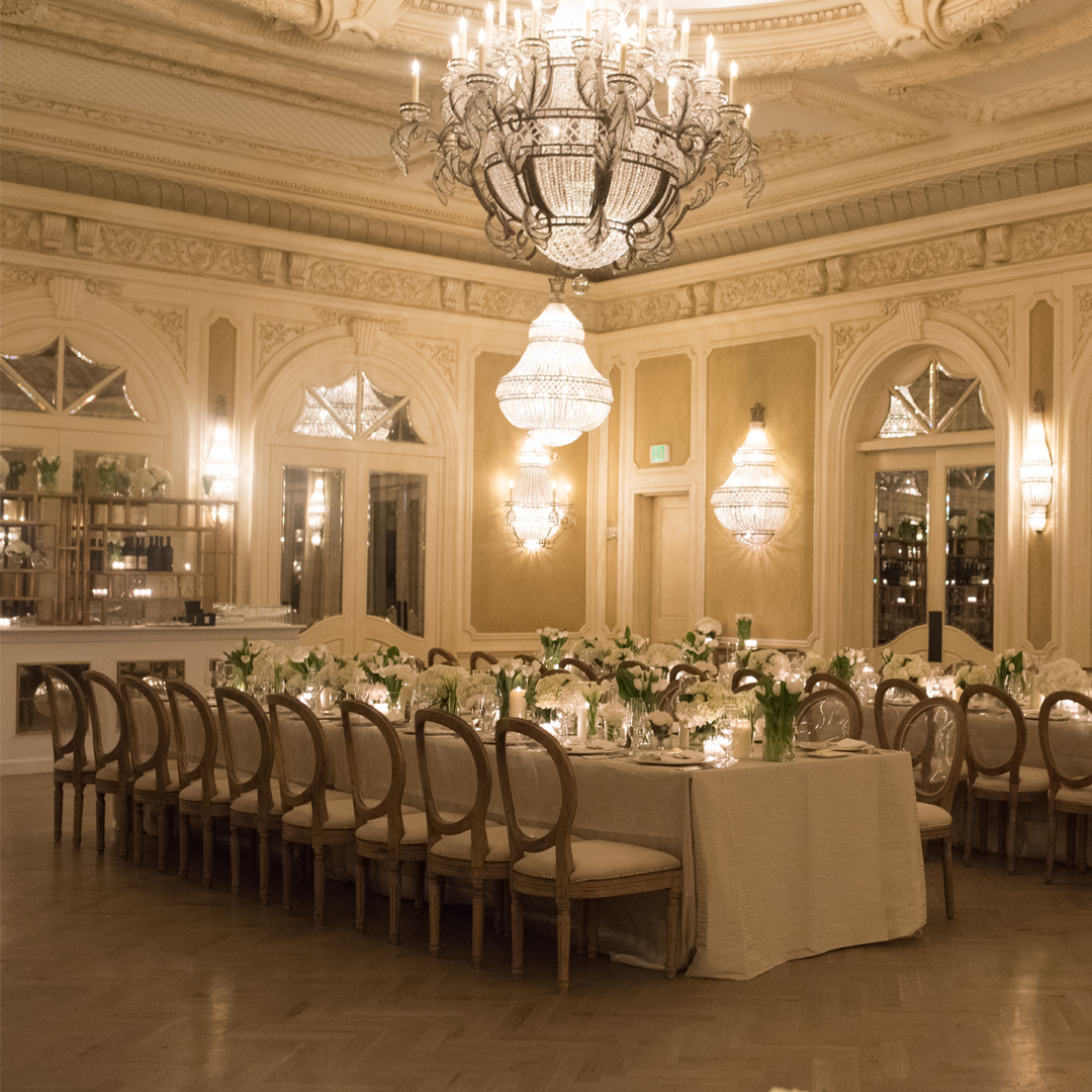 Banquet tables lined the beautiful ballroom floor