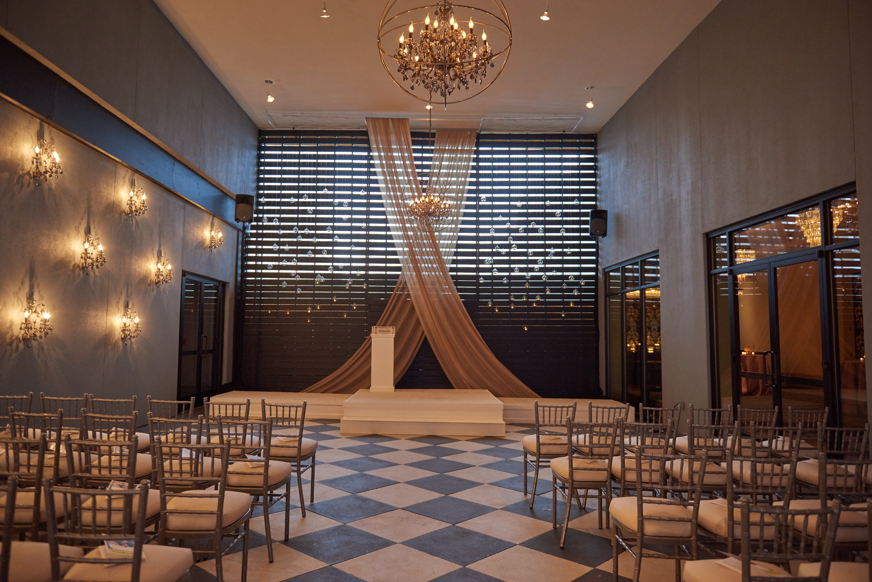 A minimalist and romantic aisle in keeping with the contemporary look and feel of the stylish Flourish courtyard, complete with suspended candles over the ceremony space.