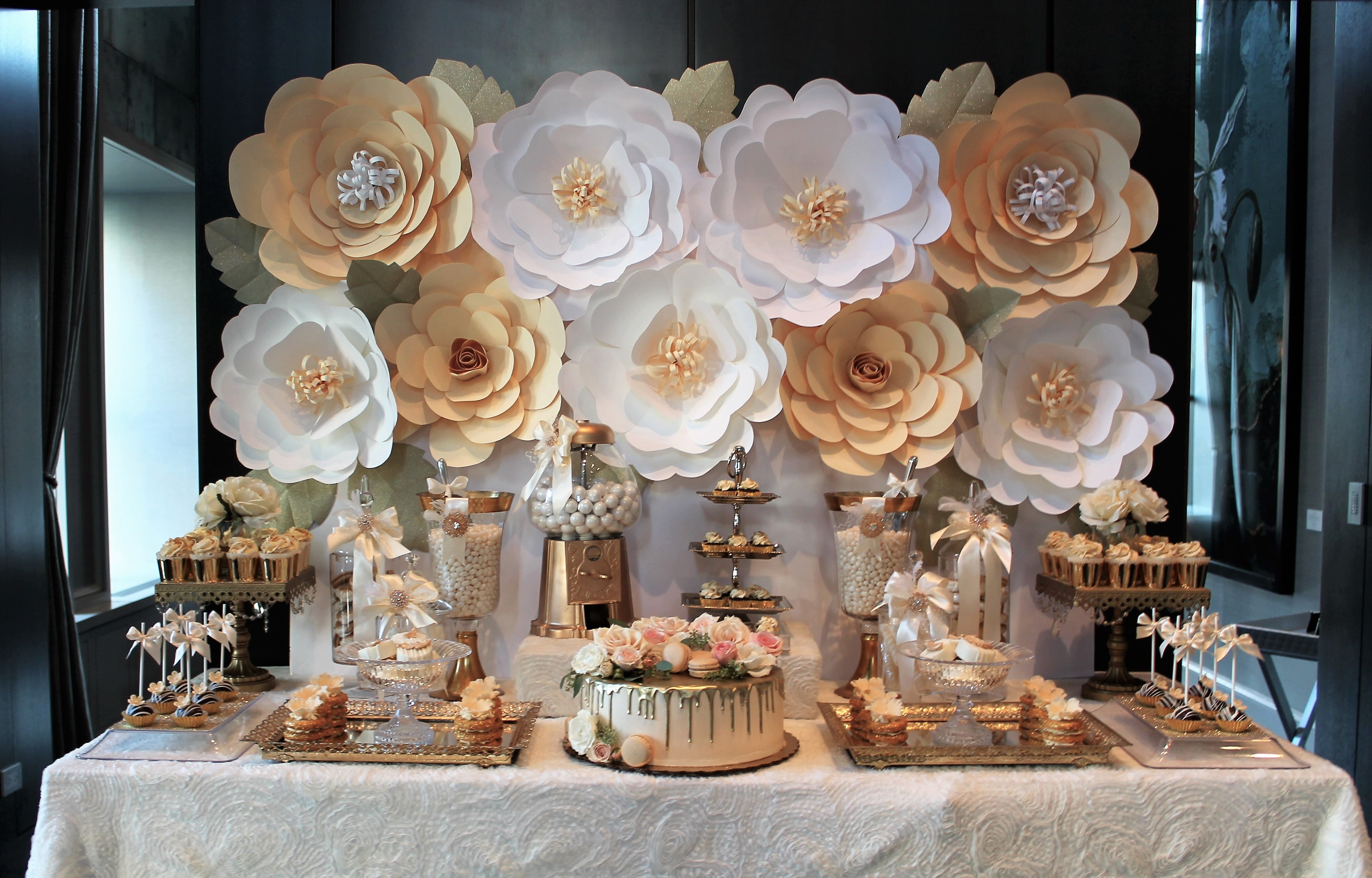 Cream and gold dessert table with a stunning paper flower wall backdrop