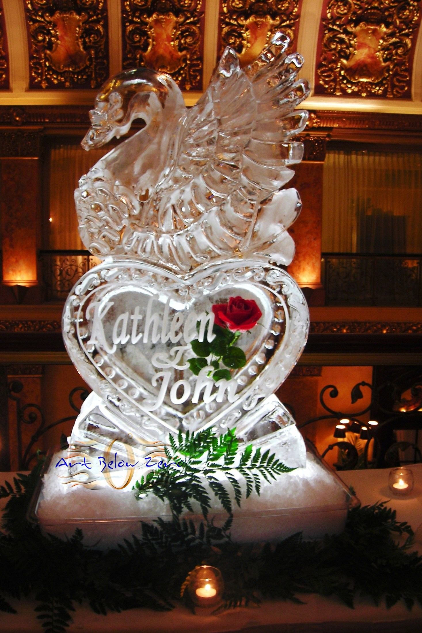 Swan on a heart with names of the bride and groom ice sculpture