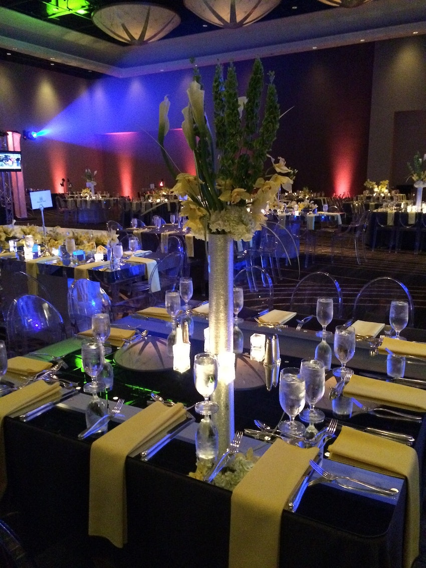 These brushed silver cylinder vases looked awesome on top of mirrored tables with bright yellow floral