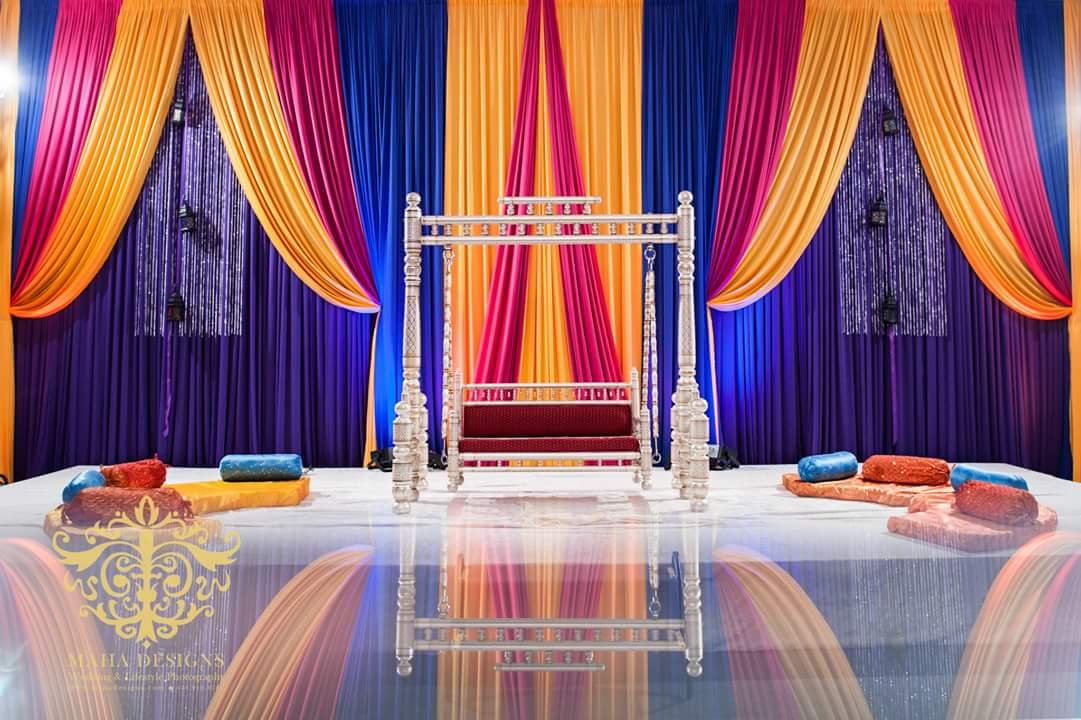 This ornate swing was the focal point of this colorful Sangeet event!