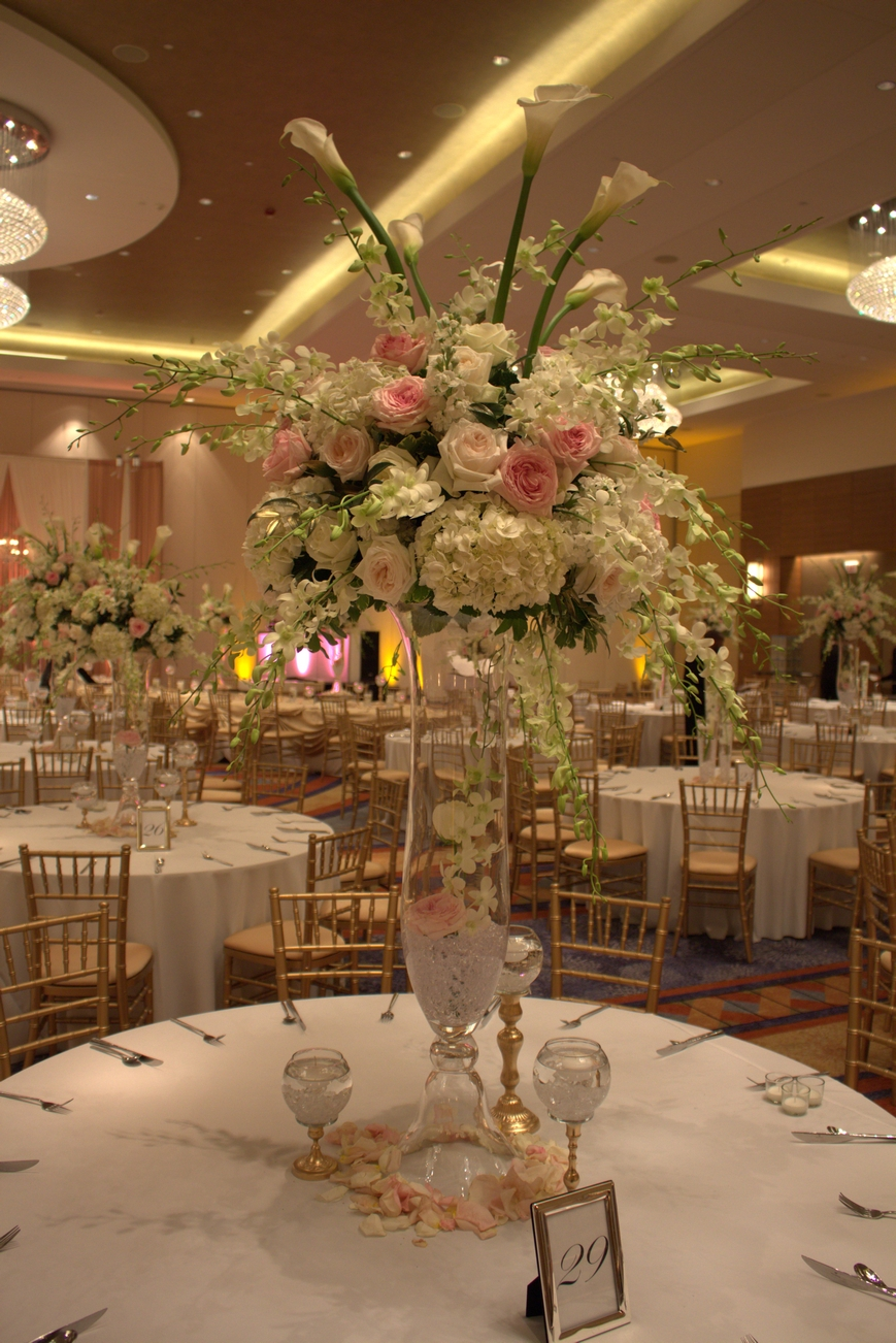Classic White Floral with a splash of pink and green enhanced this tall centerpiece