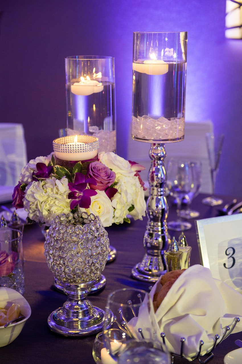 Candles, crystals and a small floral piece created a striking small centerpiece for this event.