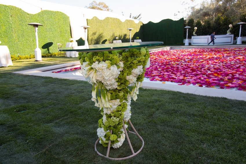 Custom floral table arrangement for the cocktail hour at a private estate in Montecito, California.