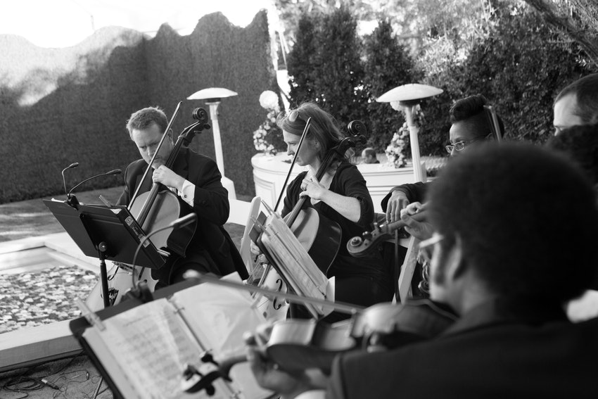 String quartet playing as guests enter the cocktail hour at a private estate in Montecito, California.