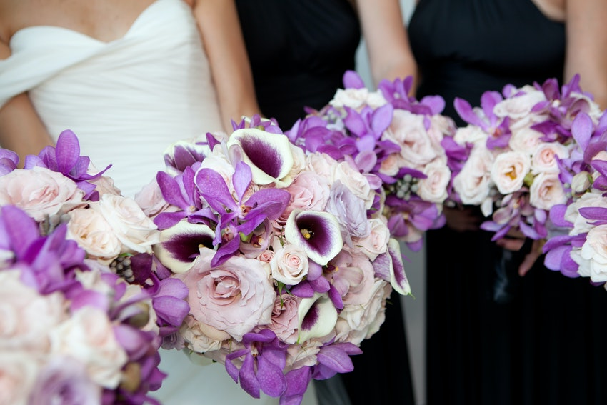 Bride and bridesmaids bouquets filled with an arrangements of purple and lavender accents.