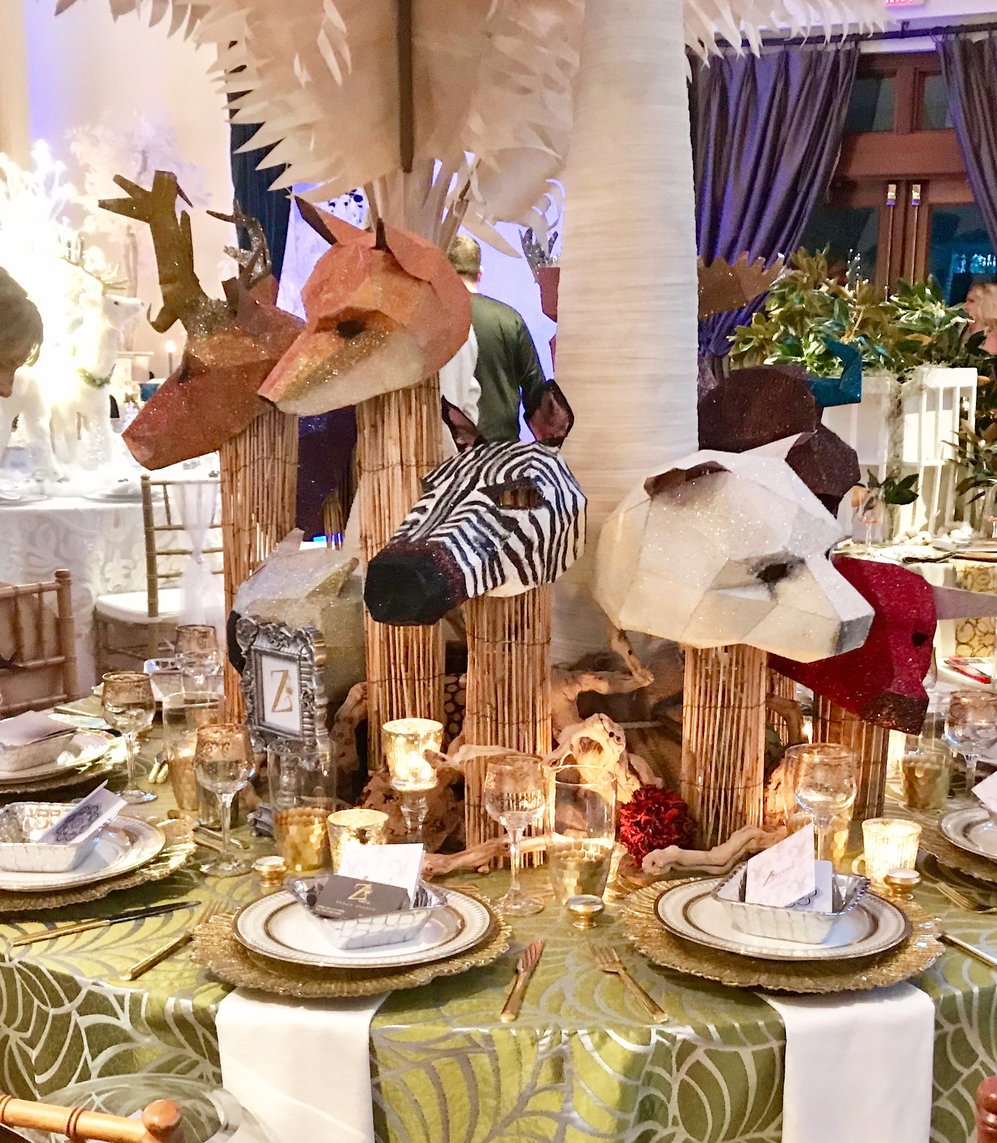"""Custom made animals painted and embellished with glitter fit the theme """"They All Asked for You"""" at the event held in the Audubon Zoo Tea Room. Each animal was designed and crafted by Nan Dupuy of Z Event Company."""