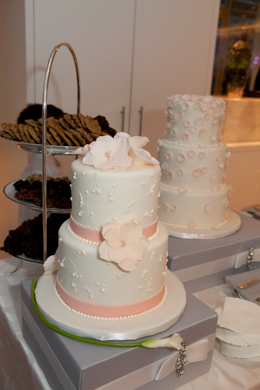 Guests enjoyed the dessert station filled with wedding cakes, cookies, and brownies.