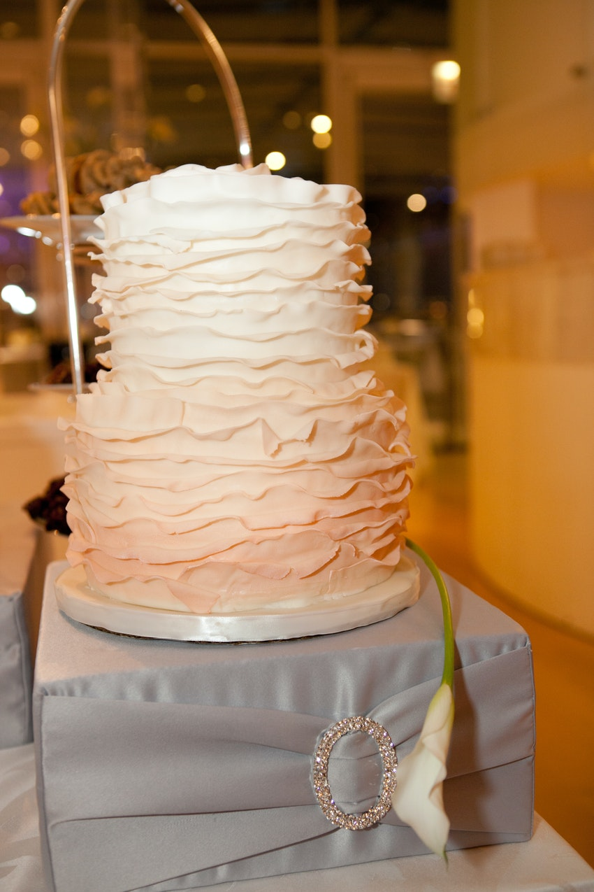 Pink, blush and white ombre colored wedding cake.