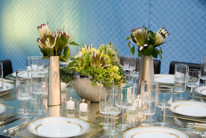 Bronze and greens make this floral more masculine appealing to all guest at this milestone birthday event.