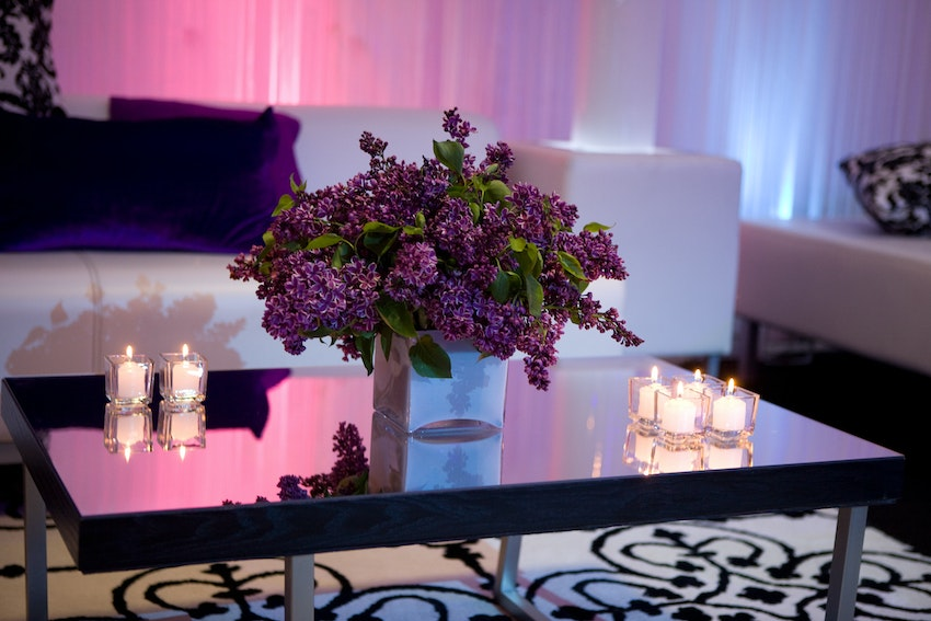 Low purple floral arrangements created a warm environment on the dancing side of the tent.