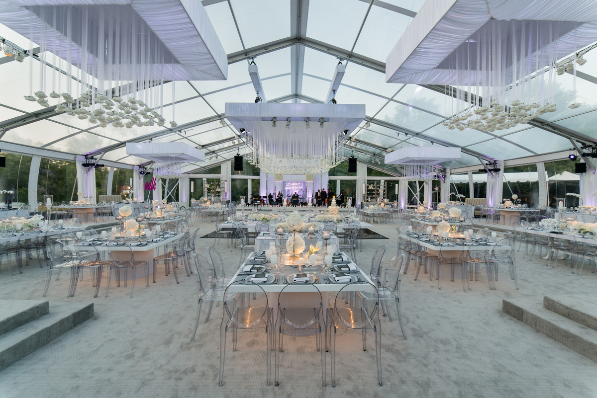 An overall shot of the elegant reception area with all white and gray custom decor.