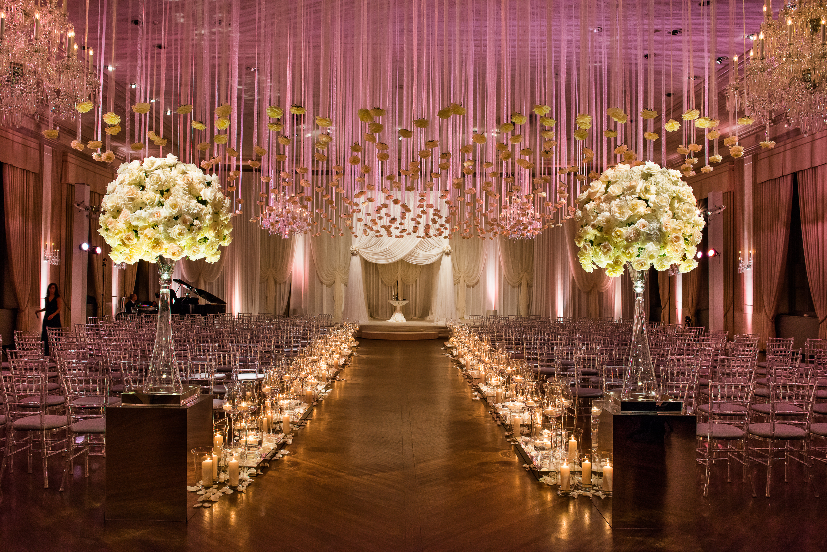 Individual roses were strung and suspended above a candlelit aisle strewn with ivory petals for a romantic Standard Club ceremony.