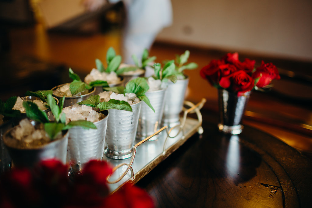 Mint juleps and red roses upon arrival to the private airport