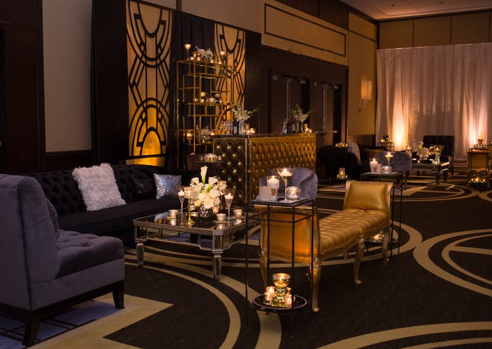 gold and black gatsby themed lounge area